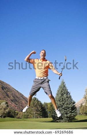Excited Golfer jumping in the air - stock photo
