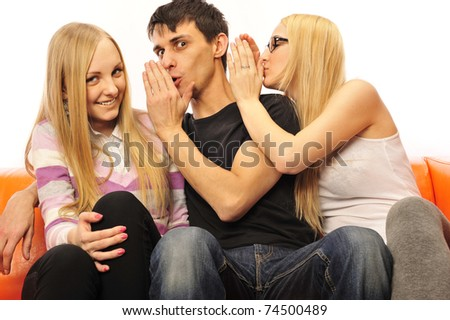 Excited group of friends at home sitting on sofa - stock photo