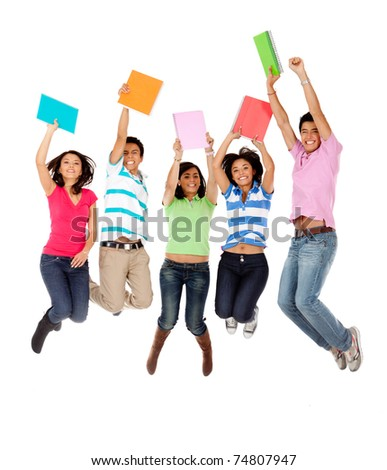 Excited group of students jumping - isolated over white - stock photo