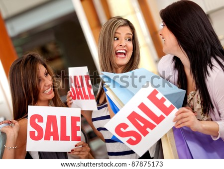 Excited group of women with bags shopping on sale - stock photo
