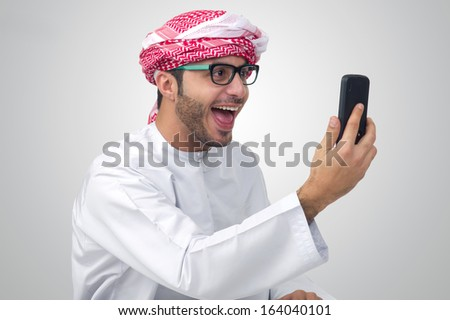 Excited, handsome Arab man expressing success - stock photo