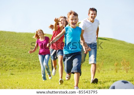 Excited happy family running - stock photo