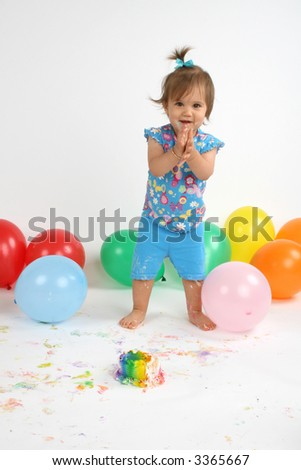 excited, happy girl at her first birthday party - stock photo