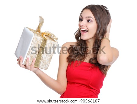 Excited happy girl with a present - stock photo