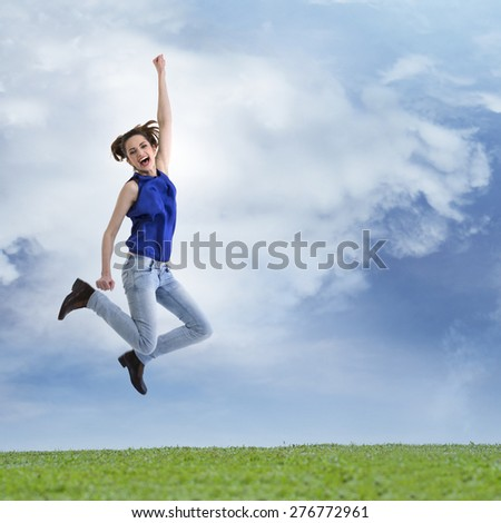 Excited & happy woman jumping for joy. Caucasian ethnicity, - stock photo