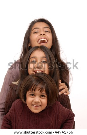 Excited, happy young indian girls in a joyful huddle