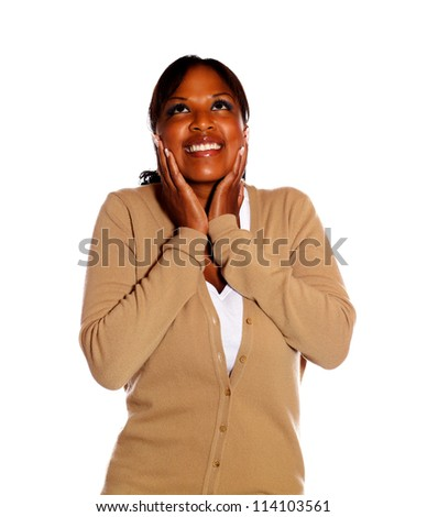 Excited happy young woman looking up on isolated background - stock photo