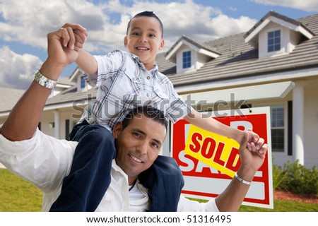 Excited Hispanic Father and Son with Sold For Sale Real Estate Sign in Front of House. - stock photo