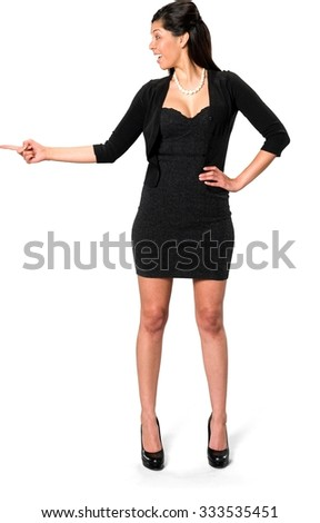 Excited Hispanic young woman with long dark brown hair in casual outfit with hands on hips - Isolated
