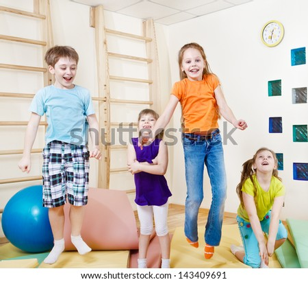 Excited jumping group of children - stock photo