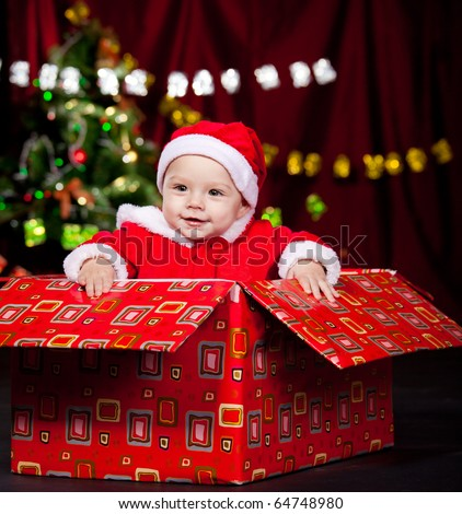 Excited kid in a present box - stock photo