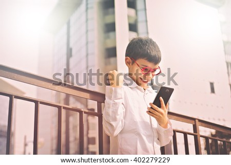 Excited kid with phone