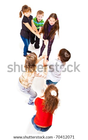 Excited kids pulling rope, isolated over white - stock photo