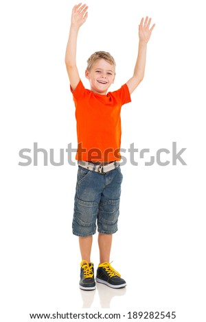 excited little boy with arms up on white background - stock photo