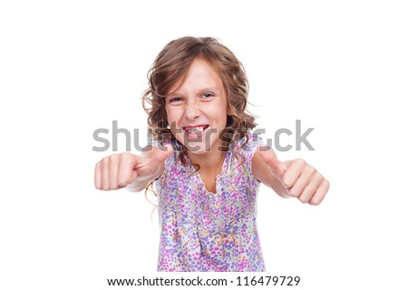excited little girl showing thumbs up. isolated on white background - stock photo
