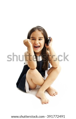 Excited little girl talking on mobile. Isolated on white background - stock photo