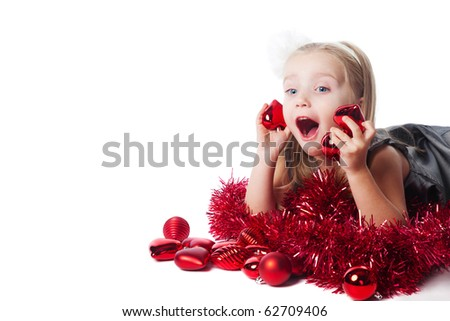 excited little girl with new year toys isolated - stock photo
