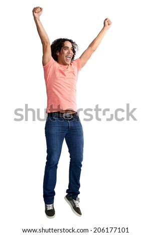 Excited male in studio with arms raised in triumph