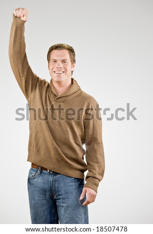 Excited man cheering and celebrating his success - stock photo