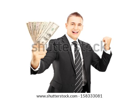 Excited man in black suit holding US dollars and gesturing happiness isolated on white background - stock photo
