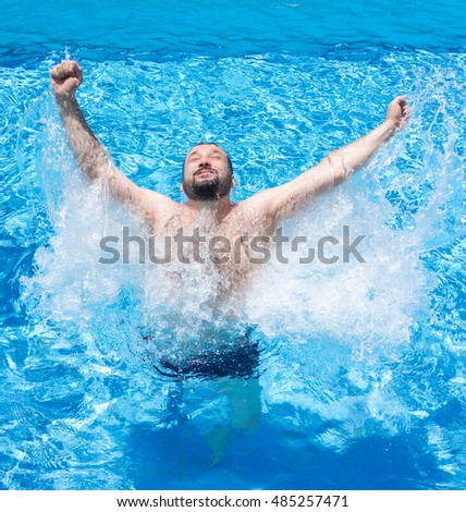 Excited man in water pool