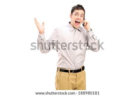 Excited man talking on the phone isolated on white background - stock photo
