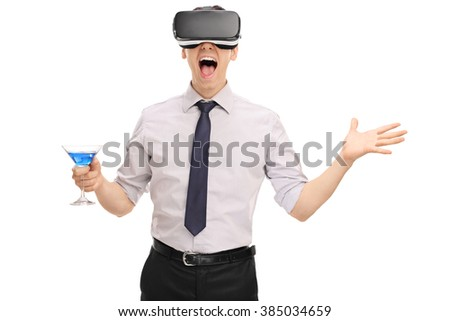 Excited man using a VR headset and holding a blue cocktail isolated on white background - stock photo