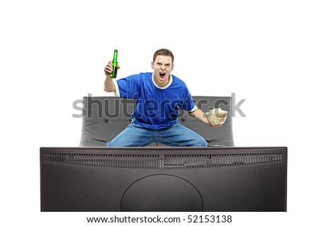 Excited man watching sport on a TV isolated on white background - stock photo