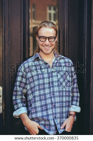 Excited man with a happy expression looking cool at the camera - stock photo