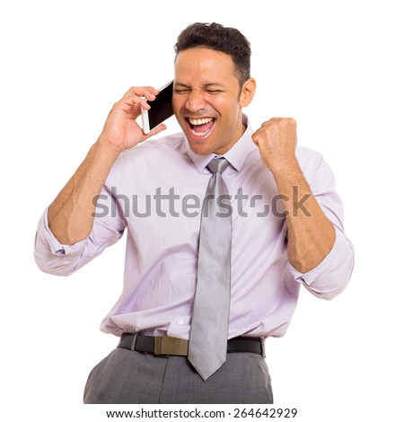 excited middle aged man talking on cell phone - stock photo