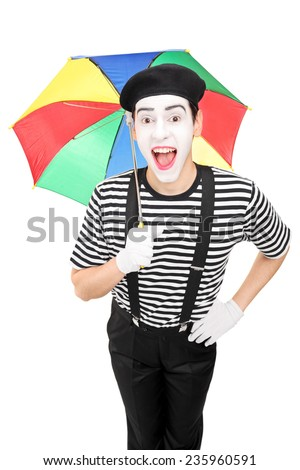 Excited mime artist holding a colorful umbrella isolated on white background - stock photo