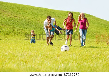 Excited parents with kids running - stock photo