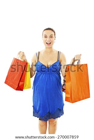Excited pregnant woman holding shopping bags. Isolated on white background   - stock photo