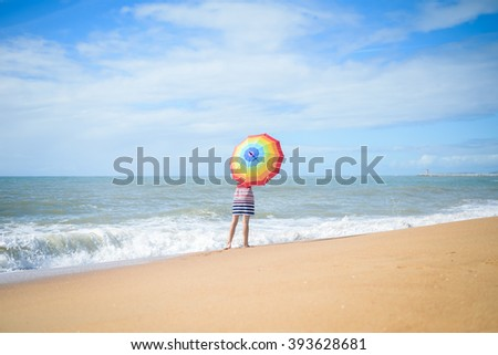 Excited romantic female having fun on beach walk on sunny background outdoors
