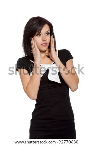 excited scared, terrified woman, young girl surprised wear black dress with white bow, looking side to empty copy space, isolated over white background