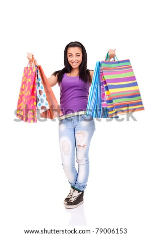 excited shopping girl with lot of bags in hands, standing on white background - stock photo