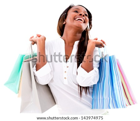 Excited shopping woman holding bags and smiling - isolated over white - stock photo