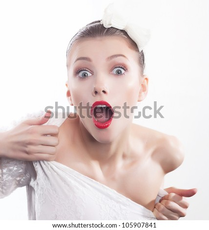 Excited shouting young pretty woman isolated on white background - stock photo