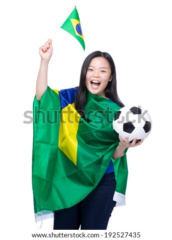 Excited soccer fans holding Brazil flag and football