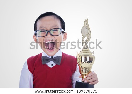 Excited student boy is holding trophy shouting for joy, isolated on white - stock photo