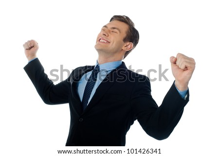 Excited successful businessman looking up against white background - stock photo
