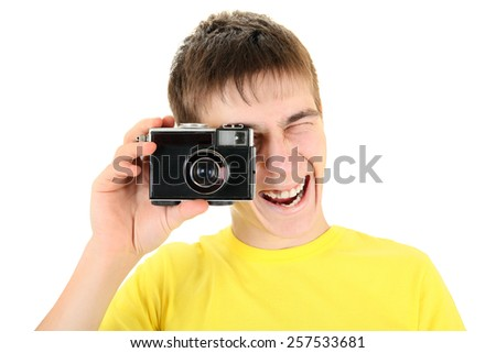 Excited Teenager Take a Picture with Vintage Photo Camera Isolated on the White - stock photo