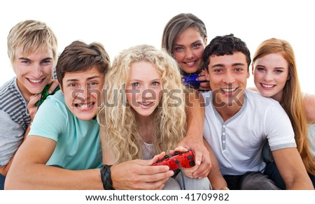Excited teenagers having fun playing video games in the living-room - stock photo