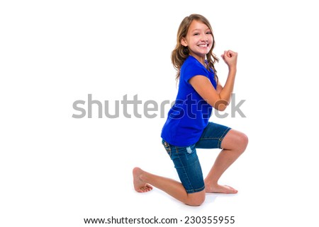 Excited winner expression kid girl hands gesture blue jeans on white background - stock photo