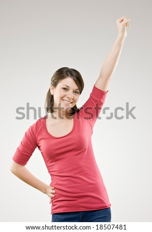 Excited woman cheering and celebrating her success - stock photo