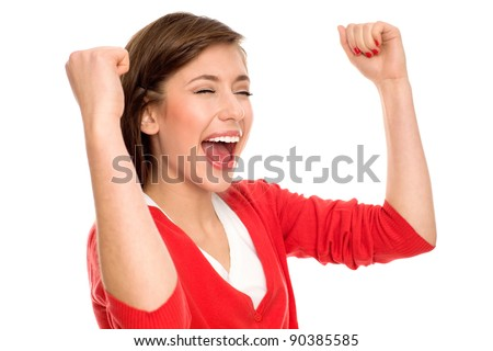 Excited woman clenching fists - stock photo