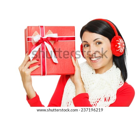 Excited Woman in Earmuffs holding a Gift Box - stock photo