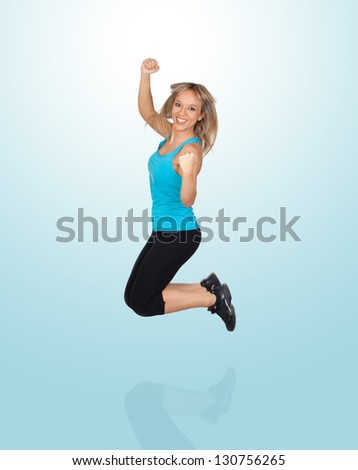 Excited Woman Jumping Isolated On Blue Background - stock photo