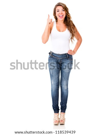 Excited woman pointing at the camera - isolated over a white background