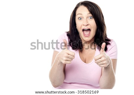 Excited woman showing double thumbs up